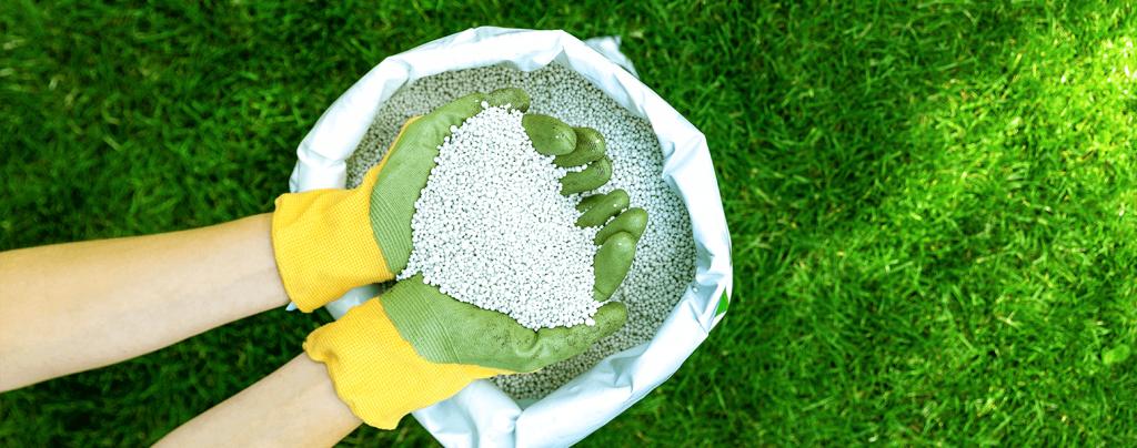 living color spring lawn care granulated lawn fertilizer hands